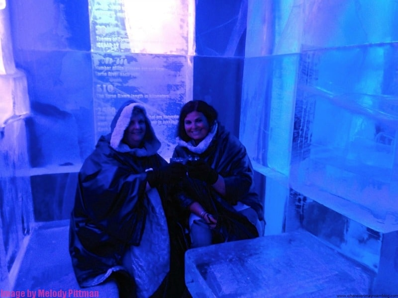 Exploring the Icebar at the Icehotel Stockholm with a friend.