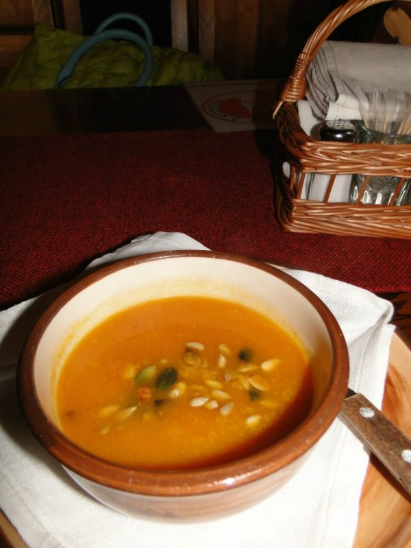 Yummy pumpkin soup with pepitas in Tallinn, Estonia.