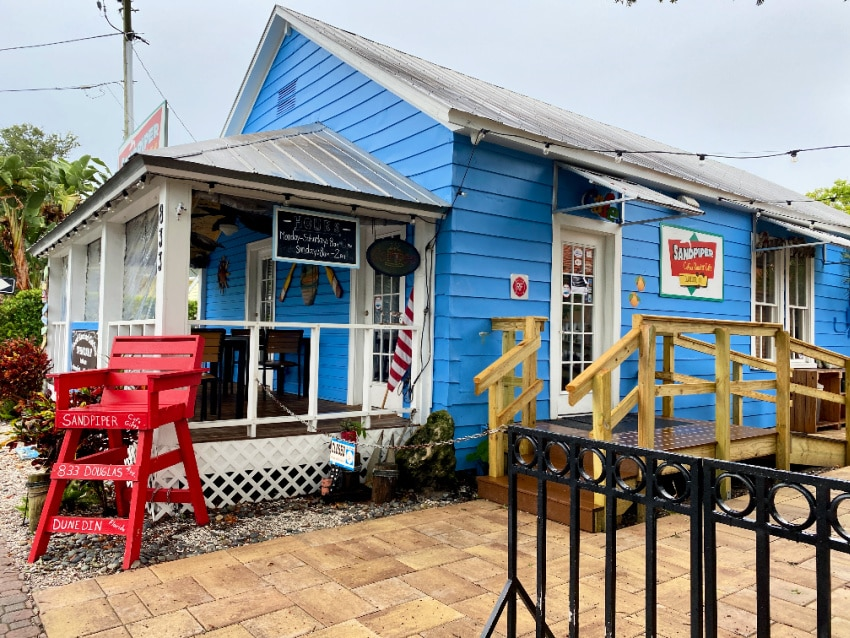local eatery in Downtown Dunedin florida with big red chair