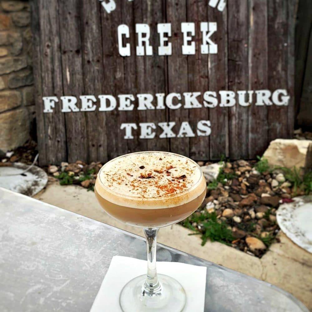 silver creek fredericksburg cocktail in courtyard