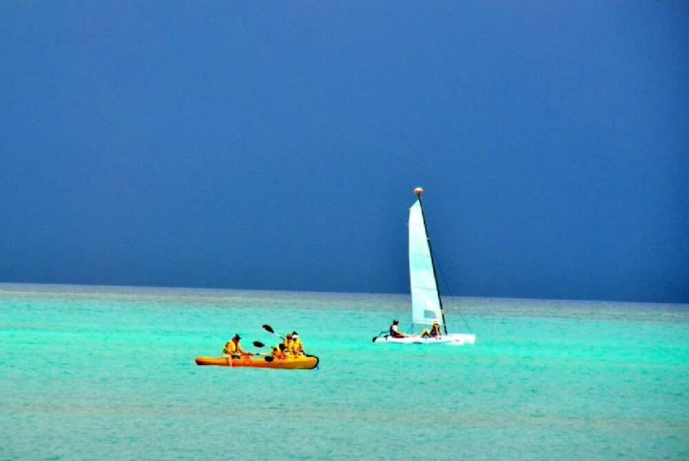 storm-on-horizon-with-boaters-and-kayakers