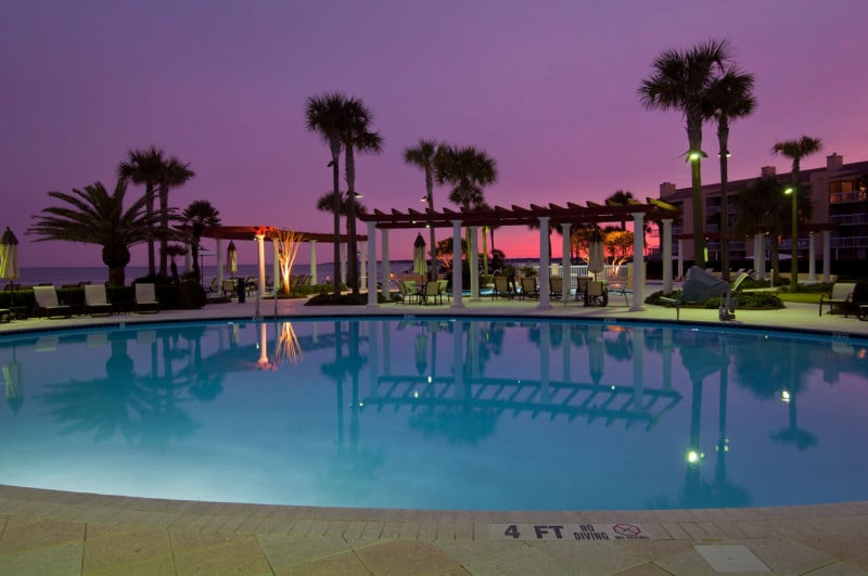 pool at sunset with purple sky