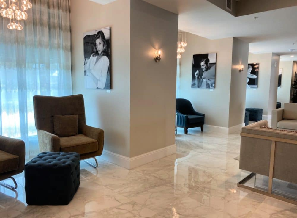 hotel legends Biloxi lobby with chairs and old hollywood photos