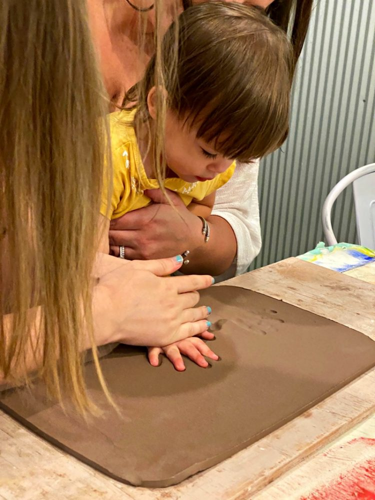 scarlett making handprint pottery