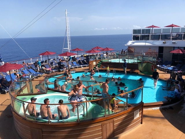 sunbathing carnival vista pool deck