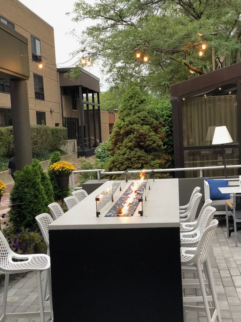 One of the best 50 things to do in upstate New York is to sip a cocktail in the attractive courtyard of the Radisson Hotel Corning's adorable courtyard.