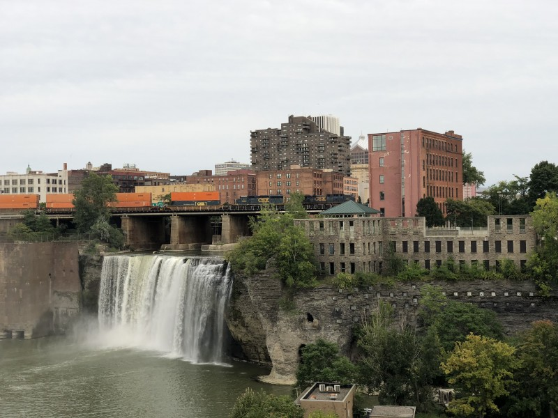 One of the best 50 things to do in the Finger Lakes is to see High Falls, a beautiful waterfall in the middle of downtown Rochester.