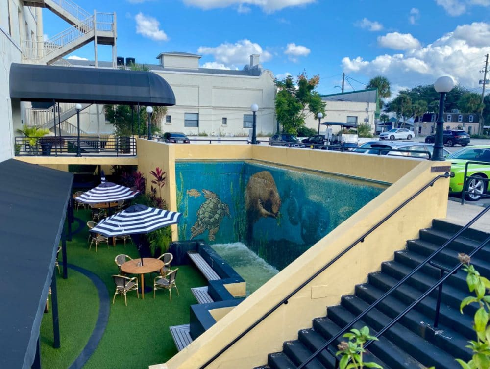 downtown deland outdoor patio at restaurant with mural