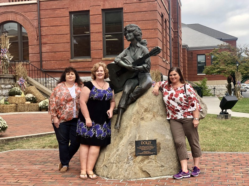 picture with Dolly Parton Statue downtown sevierville