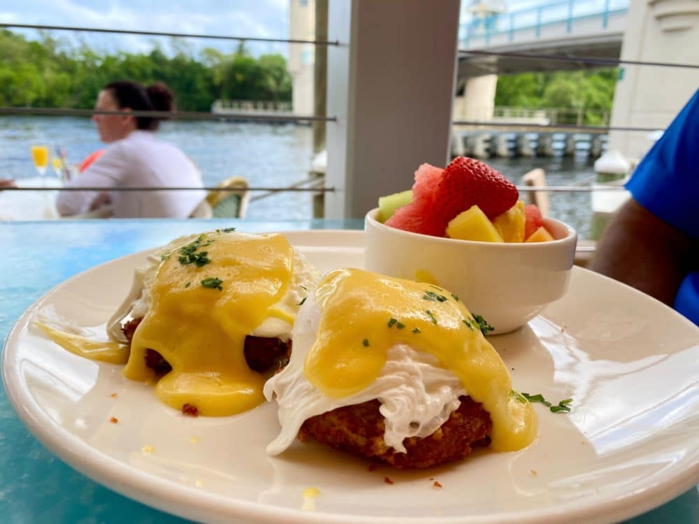 eggs Benedict from banana boat on outdoor patio