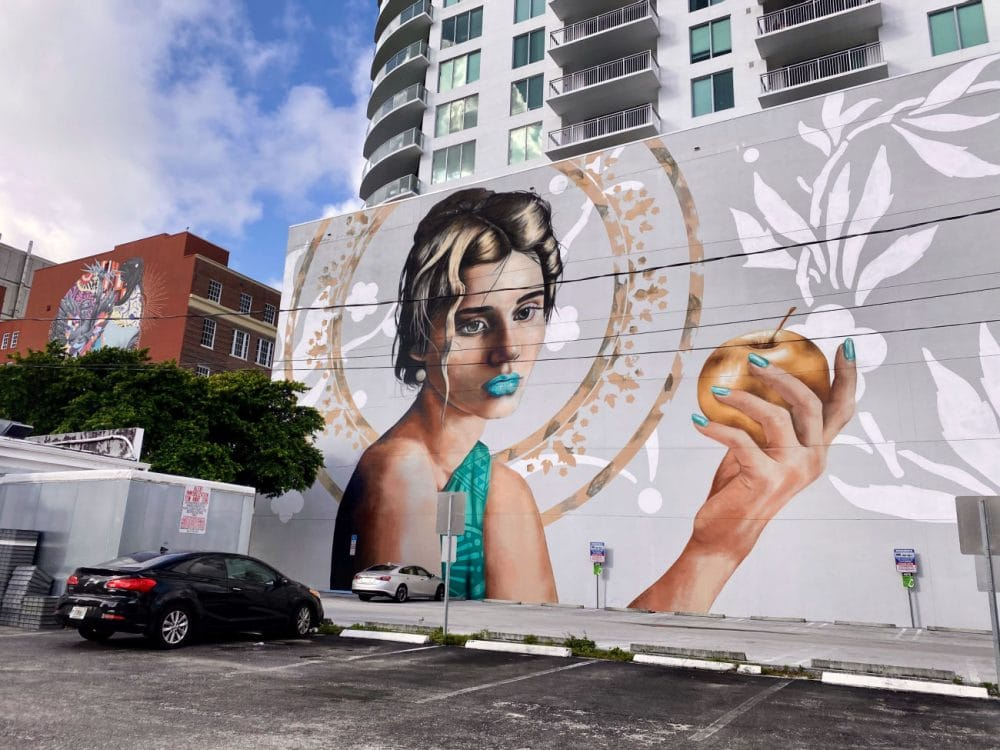 girl with apple mural in west palm beach