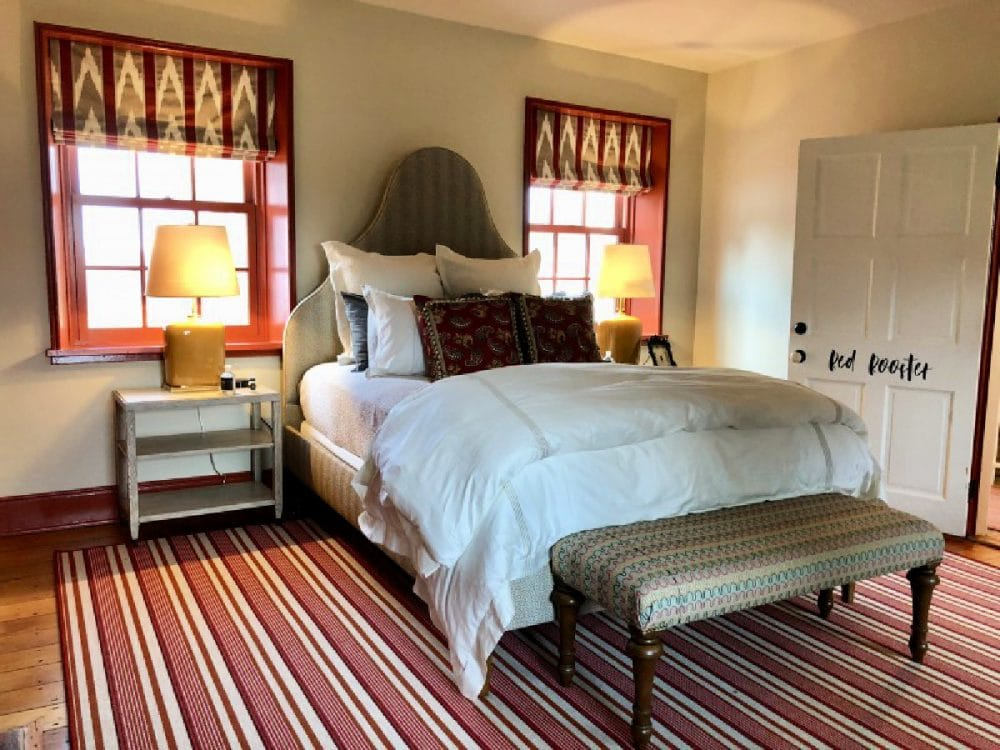 room at inn at tusculum farm with red rug