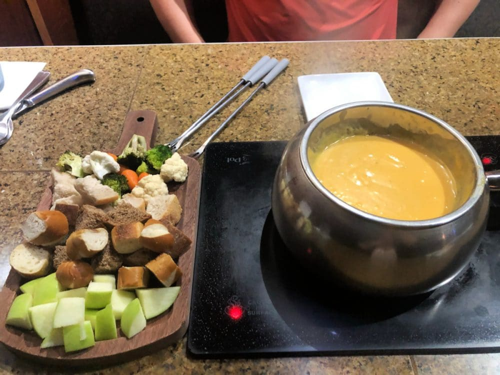 melting pot cheese fondue with dippers