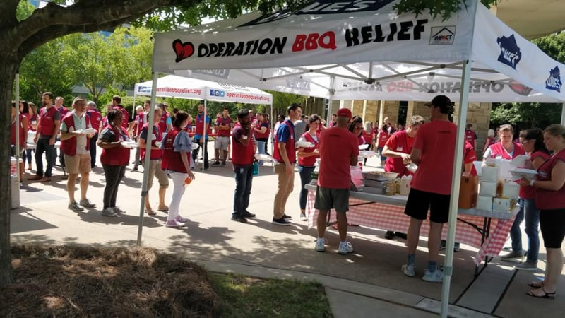 operation bbq relief tent and line of people