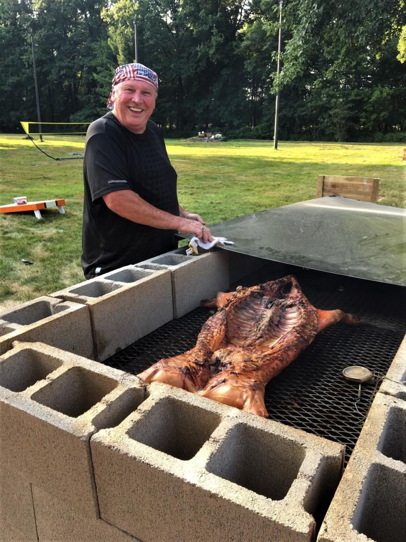 Alan nichols obr supserstar barbecuing over pit