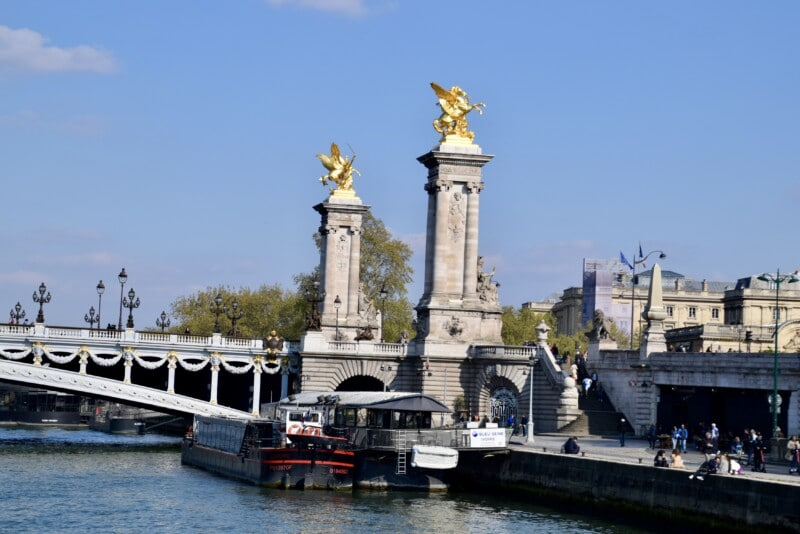 Paris bridge and columns view from the river