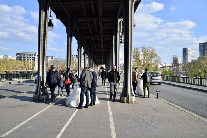 wedding photos being taken on a bridge in Paris
