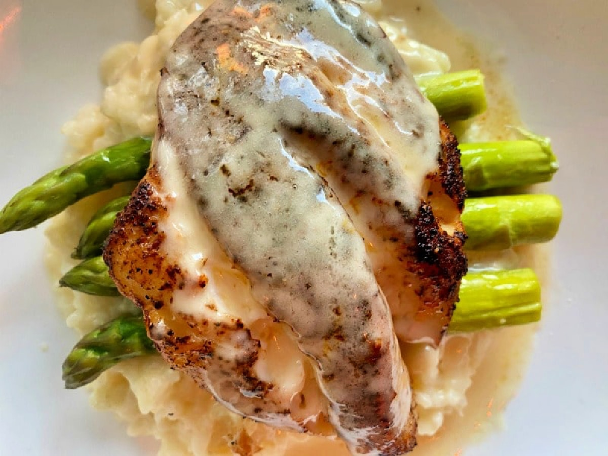 grouper over asparagus and risotto