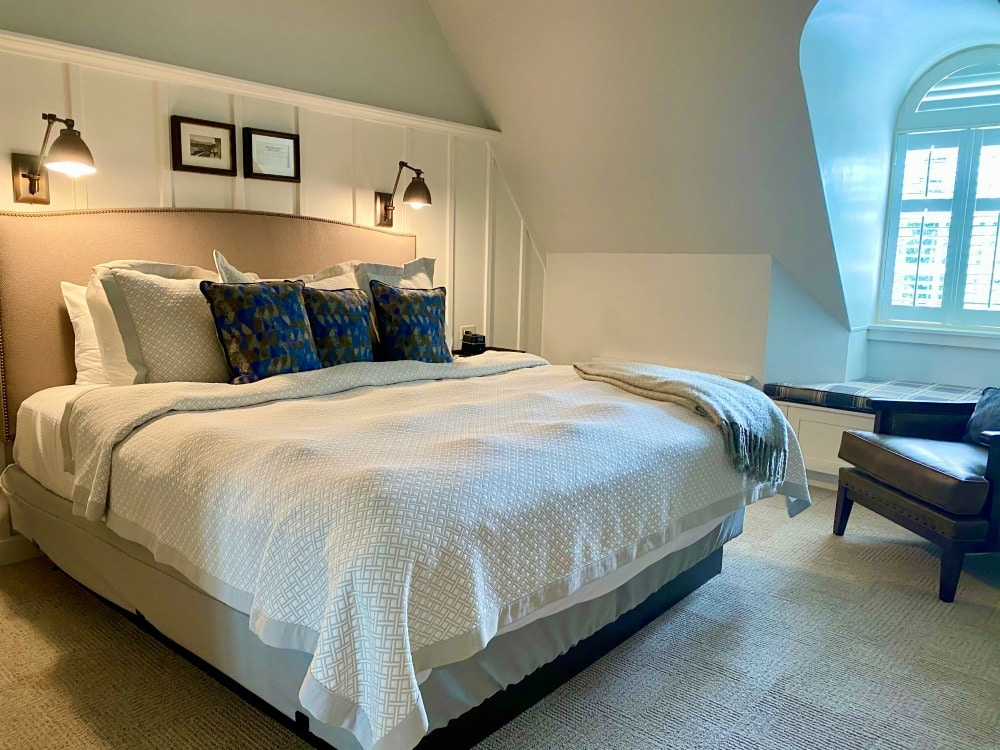 bed with pillows and dorner window