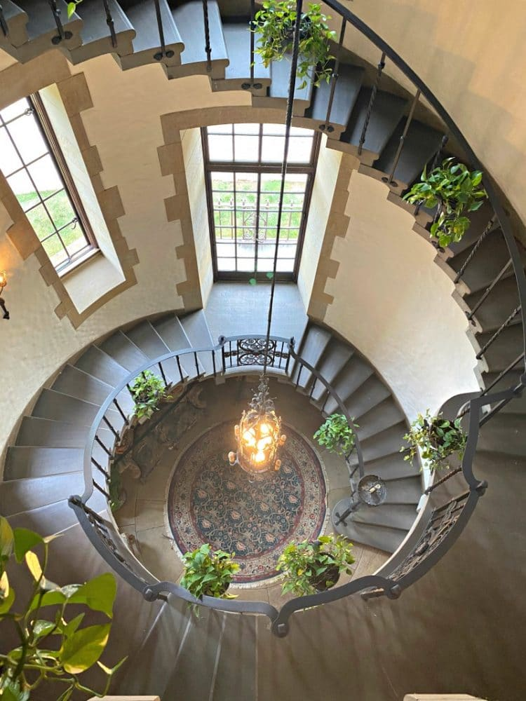round stairway with plants at graylyn estate