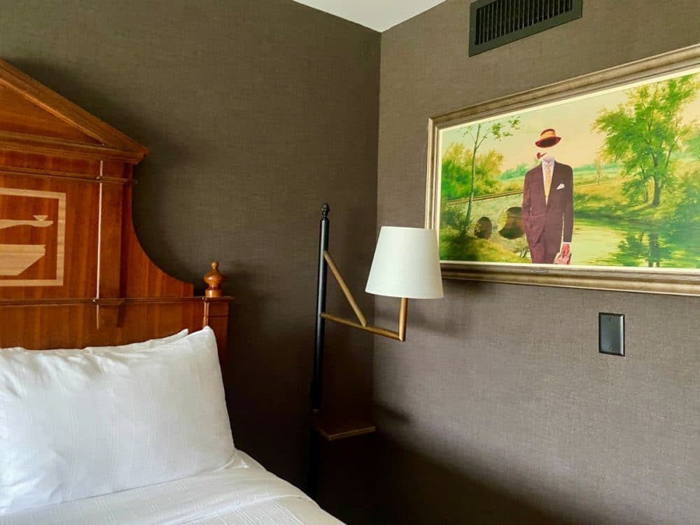 graduate hotel bed and painting