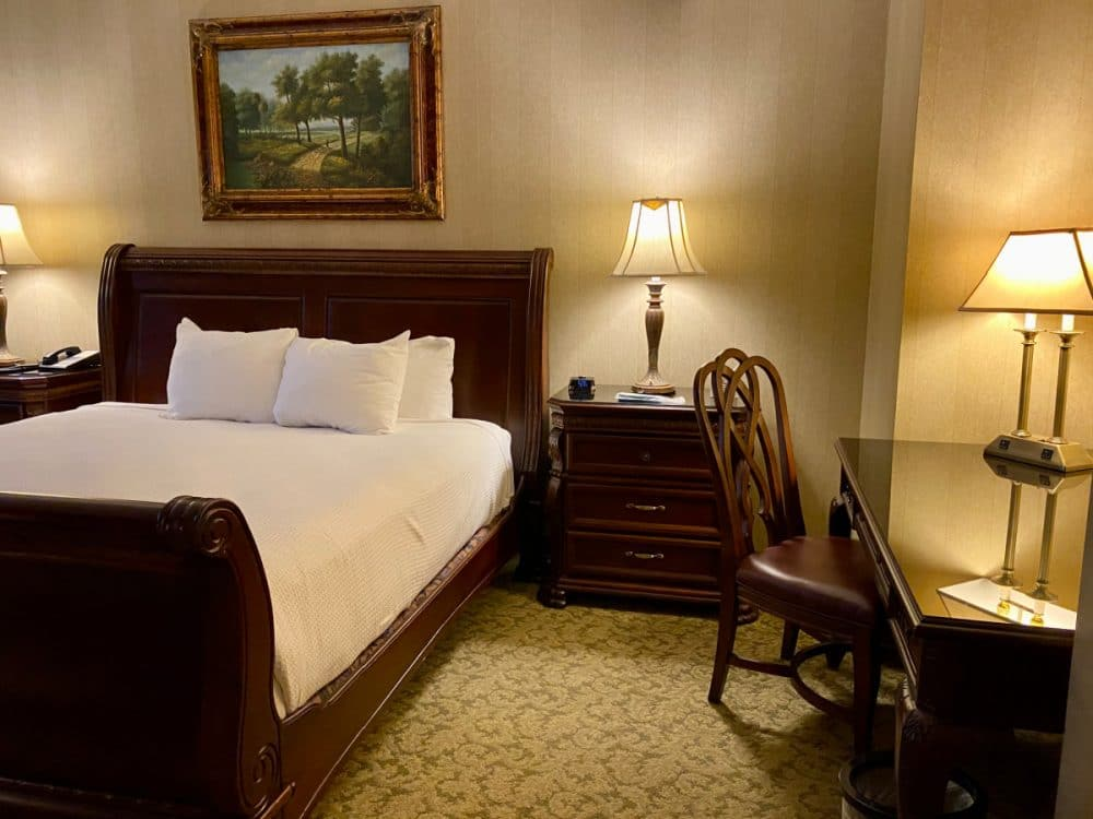 sleigh bed and desk at Carnegie hotel