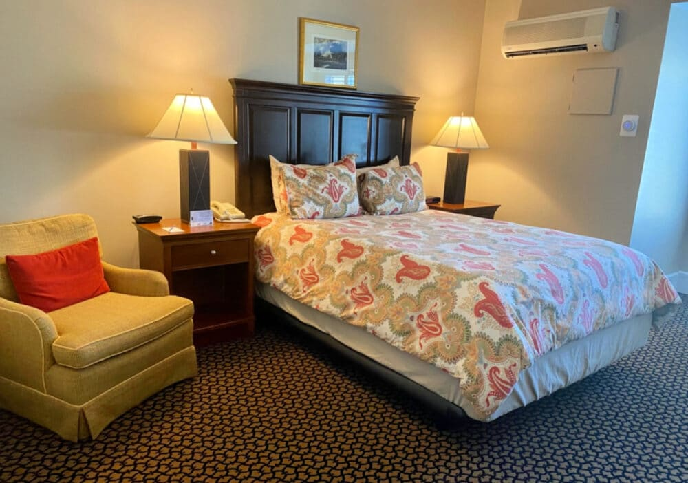 bed-and-chair-at-Davidson-village-inn